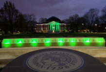 Grawemeyer is lit green to honor COVID-19 victims in 2020.